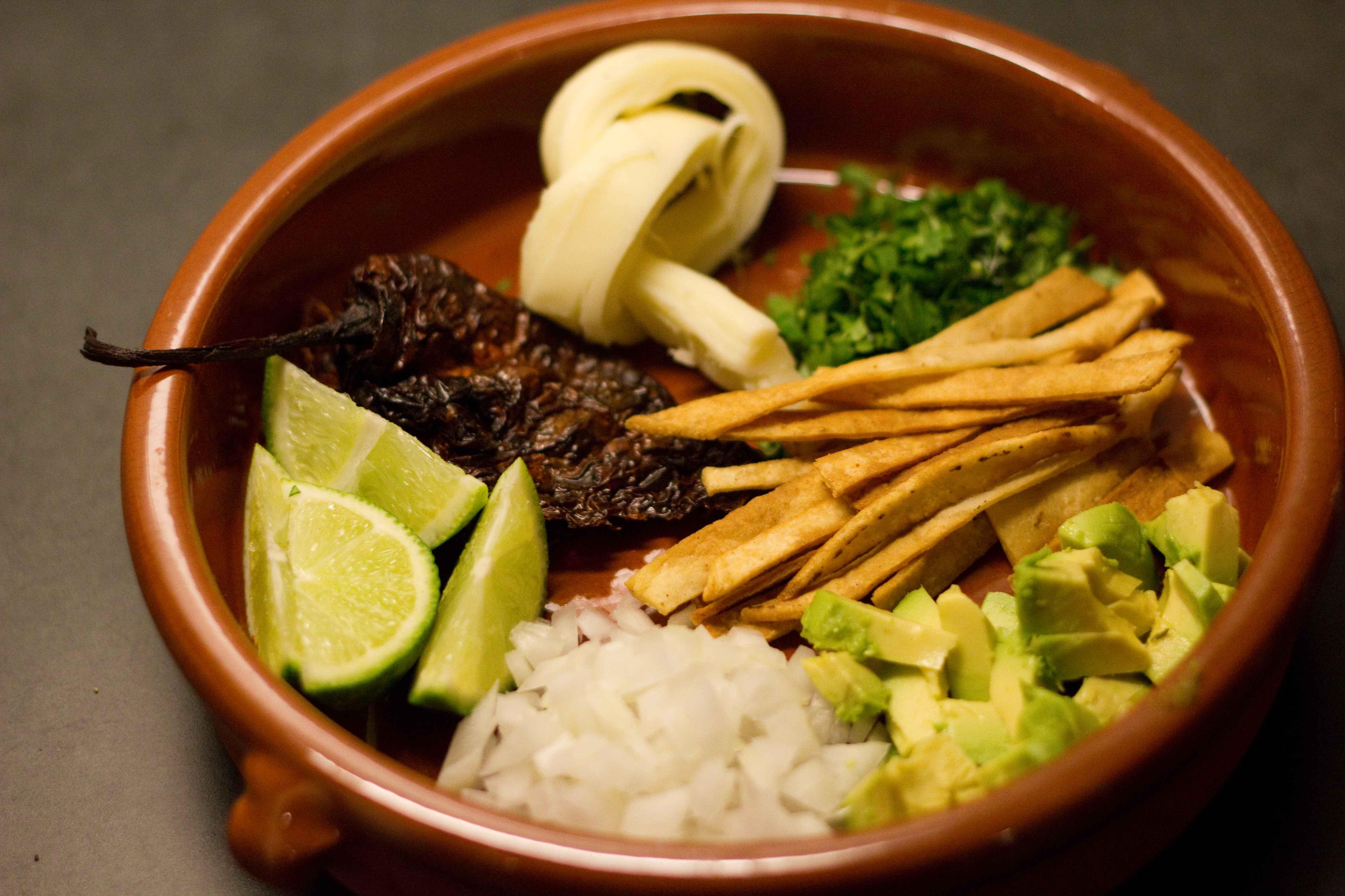 ... , cilantro, tortilla strips, avocado, onion, lime and pasilla chiles