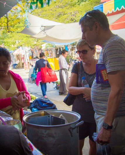 Tom and Molly picking out our tamales.