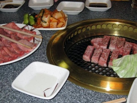 Cabbage and onion on the grill coupled with a side of kimchi are great accompaniments to the melt in your mouth beef.