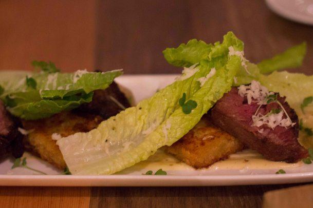 Medium rare beef short rib with potato and cheddar terrine, caesar aioli, romaine and horseradish