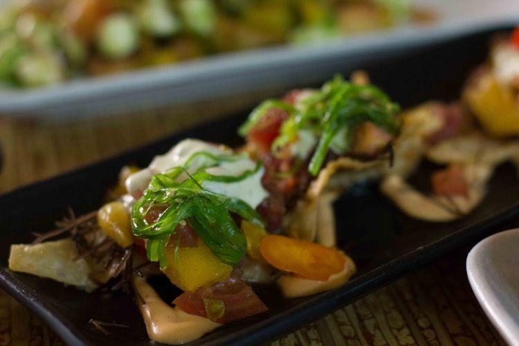 Poke nachos - Ahi Poke on wonton chips with wasabi cream, roasted pepper aioli and sweet soy