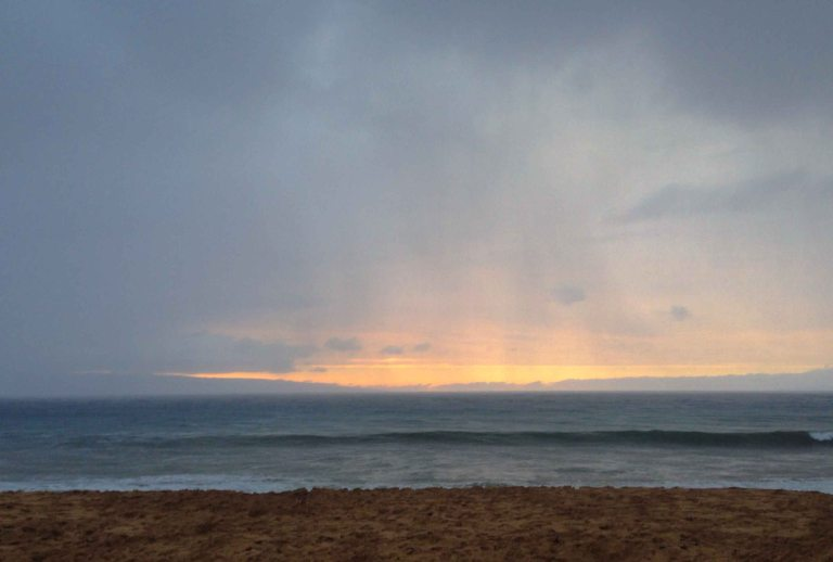 Standing in the rain to watch the sunset in the distance would become a regular occurrence for me in Maui.