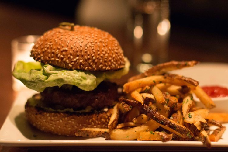 Burger with onions, goat cheese, pickles, butter lettuce, brioche, fries = one fantastic burger