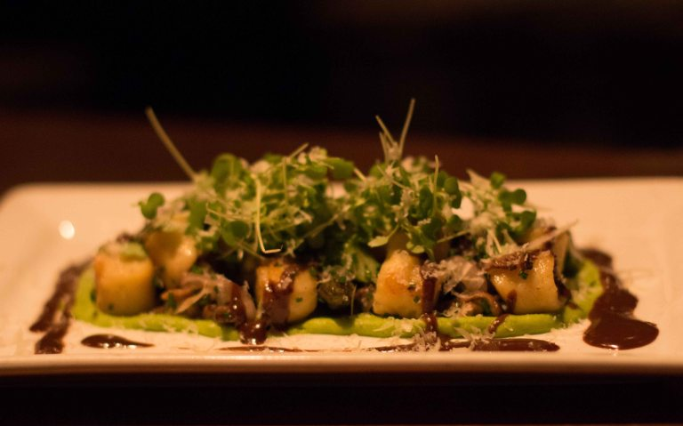 Sheep Cheese Gnocchi, pea purée, asparagus, mushrooms, black garlic