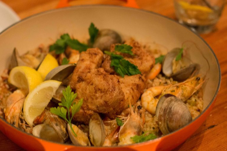 Lowcountry seafood pilau with Charleston gold rice, field peas, clams, shrimp and crispy fish