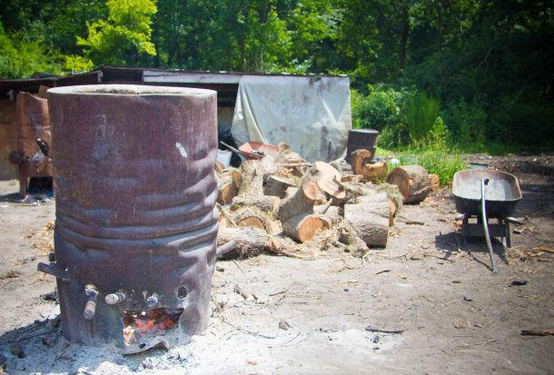 The burn barrel, where wood is placed on fire. What comes out the bottom are the charcoal embers which are used to cook the pig.