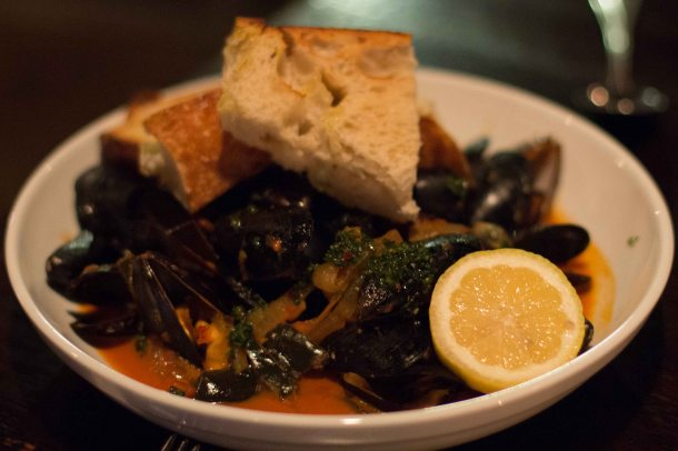 PEI mussels, San Marzano, bacon, hickory smoke, PBR, chimichurri with toast.