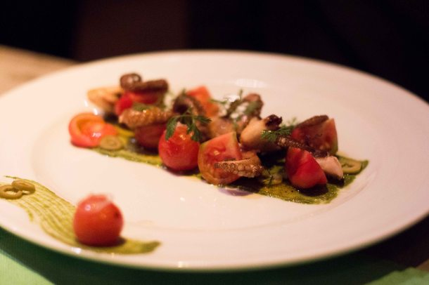 Grilled octopus salad with pesto and tomatoes. A great example that delicious can be achieved with simply with good ingredients and techniques.
