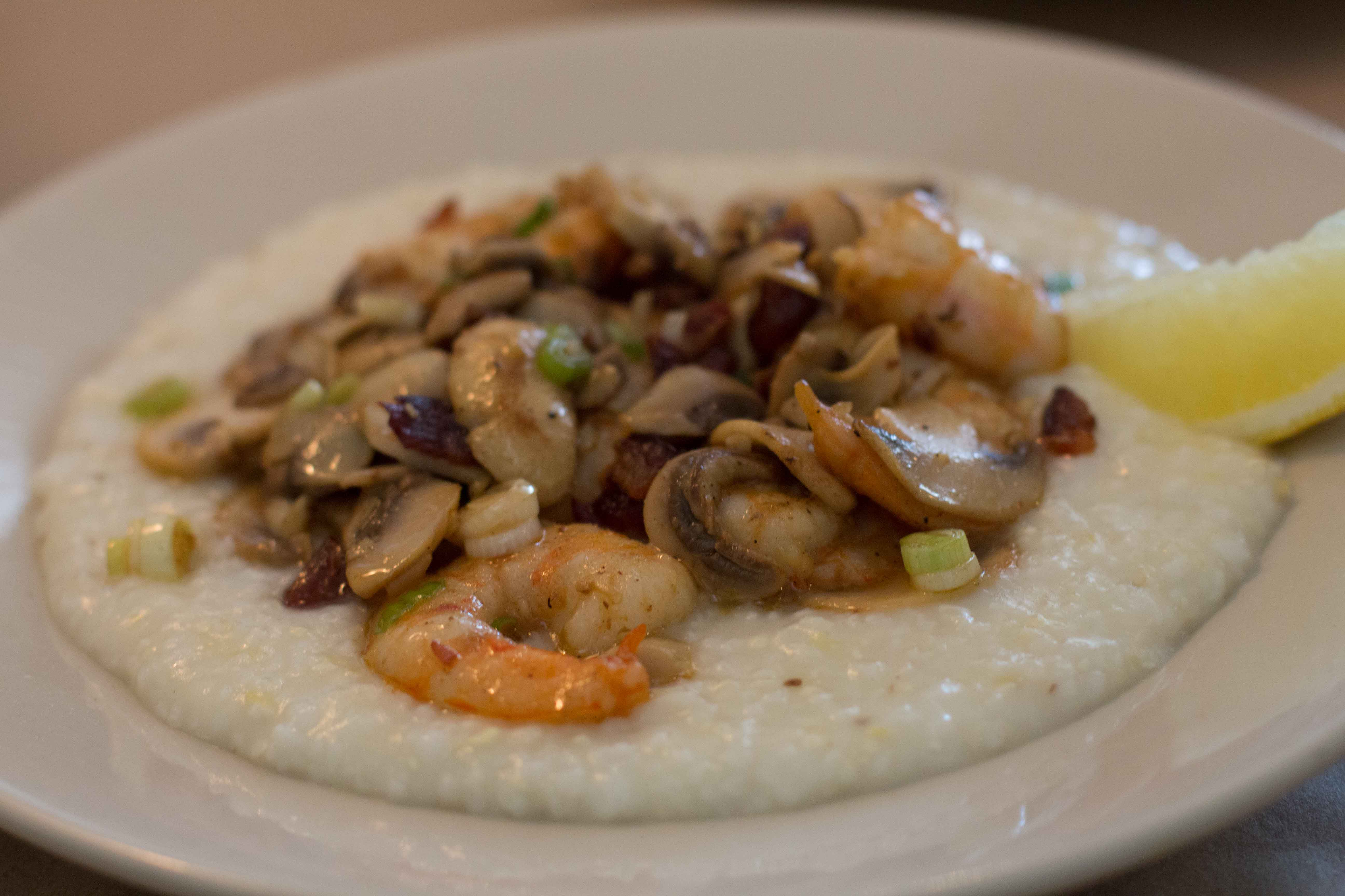 Shrimp and cheese grits with sautéed scallions, mushrooms and bacon