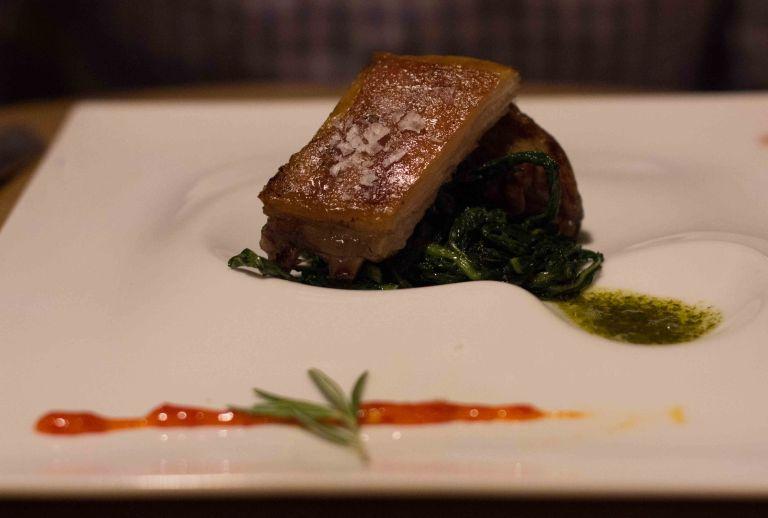 """Churrasco y Chimichurri"" lamb with chimichurri sauce, chicory and hot pepper"