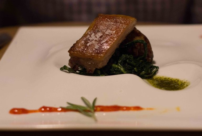 """Churrasco y Chimichurri"" lamb with chimichurri sauce, chicory and hot pepper"