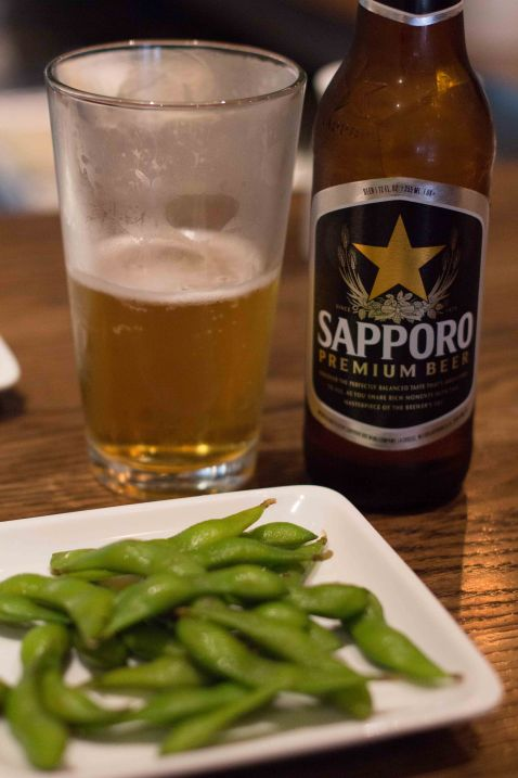 Edamame with a small Sapporo beer and a big cup